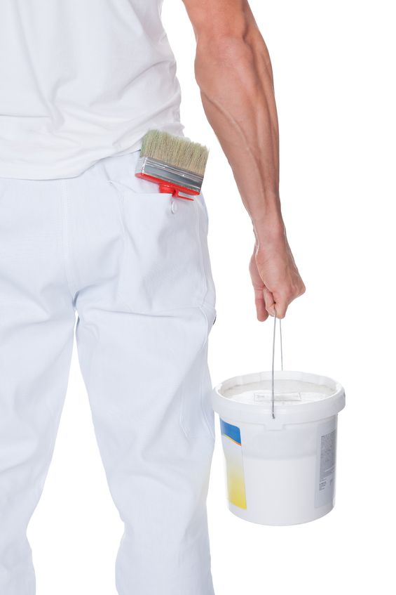 painter holding a paint bucket